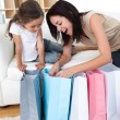 Happy Mother and daughter unpacking shopping bags — Stockfoto