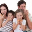 Happy family eating pizza - Stock Photo