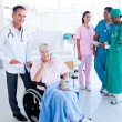 Positive medical team taking care of a senior woman — Stock Photo #10825979