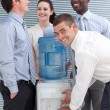 Stock Photo: Busines colleagues talking around water cooler