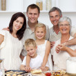 Happy family baking in the kitchen — Stock Photo #10826106