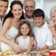 Portrait of parents, grandparents and children baking in the kit — Stock Photo #10826111
