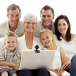 Happy family using a laptop at home — Stock Photo