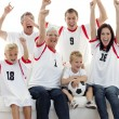 Stock Photo: Family celebrating a goal at home
