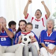 Family watching football match in television — Stock Photo #10826133