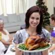 Woman showing Christmas turkey for family dinner — Stock Photo
