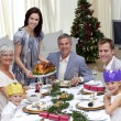 Family celebrating Christmas dinner with turkey — Stock Photo #10826146