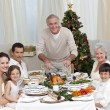 Grandfather cutting turkey for Christmas dinner — Stock Photo