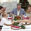 Children pulling a Christmas cracker at home — Stock Photo #10826159
