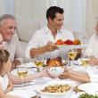 Family having a big dinner at home -  