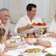 Stock Photo: Family having big dinner at home