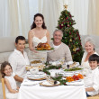 Family celebrating Christmas dinner with turkey — Stock Photo #10826164
