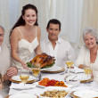 Family eating turkey in a dinner — Stock Photo #10826170