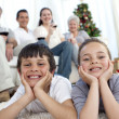 Brother and sister on floor with their family in Christmas — Stock Photo #10826172