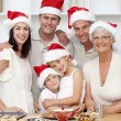 Smiling family baking Christmas cakes — ストック写真