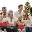 Happy family at home opening Christmas presents — Stock Photo