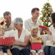Royalty-Free Stock Photo: Happy family at home opening Christmas presents