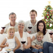 Family drinking wine and eating sweets in Christmas — Stock Photo #10826191
