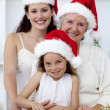Daughter, mother and grandmother baking Christmas cakes — Stock Photo