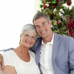 Portrait of mature couple celebrating Christmas — Stock Photo