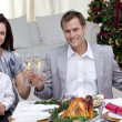 Stock Photo: Parents toasting with wine in Christmas dinner