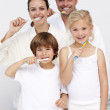 Parents and children cleaning their teeth in bathroom — Stock Photo