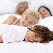 Family resting in parent's bed — Stock Photo