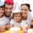Family celebrating daughter's birthday at home - Stock Photo