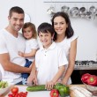 Smiling family cooking together — Stock Photo