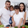 Stock Photo: Affectionate young family cooking together