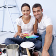 Couple with colour samples to paint new appartment — Stock Photo