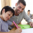 Father helping his son doing homework — Stock Photo