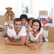 Happy family after buying new house — Stockfoto #10826366