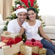 Happy couple celebrating Christmas at home — Stock Photo
