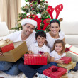 Happy family celebrating Christmas at home — Foto de Stock