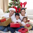 Happy family celebrating Christmas at home — Stock fotografie #10826381