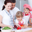 Portrait of a family preparing a meal — Stock Photo
