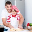 Portrait of a smiling father and his son preparing a meal - Stock fotografie