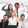 Happy business team celebrating a success in office — Stock Photo #10826447