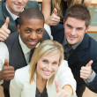 Royalty-Free Stock Photo: High view of happy business team with thumbs up