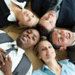 Closse-up of business lying in a circle on the floor — Stock Photo #10826482