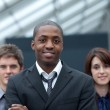 Afro-American businessman leading his team — Stock Photo