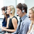 Attractive young man working in a call center — Stock Photo