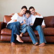 Parents and kid using a laptop with thumbs up — Stock Photo