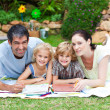 Happy family painting in a park smiling at the camera — Stock Photo #10826537