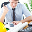 Concentrated male architect studying a project — Stock Photo #10826597