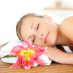 Portrait of a cute woman having a massage — Stock Photo #10826623