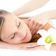 Relaxed woman receiving a back massage — Stock Photo #10826627
