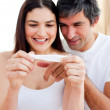 Blissful couple finding out results of a pregnancy test - Zdjcie stockowe