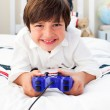 Stock Photo: Happy boy playing video games